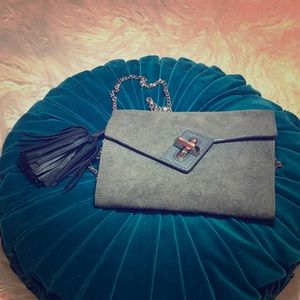 Suede clutch with leather tassel & chain strap